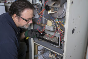 technician-fixing-furnance-for-brookfield-illinois-home-listing