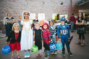 children in costume inside a building