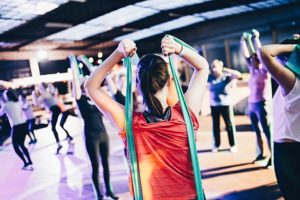group of people exercising with elastic bands