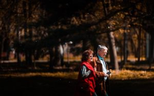 man and woman walking in a park