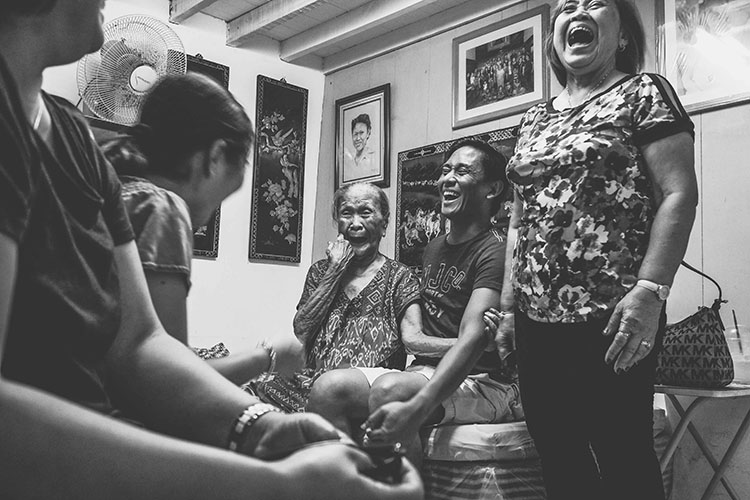 people laughing in a living room