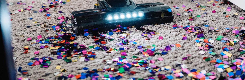 vacuuming confetti from carpet